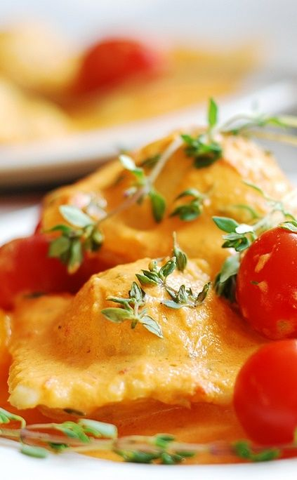 Ravioli with spinach and ricotta cheese filling, in tomato ...