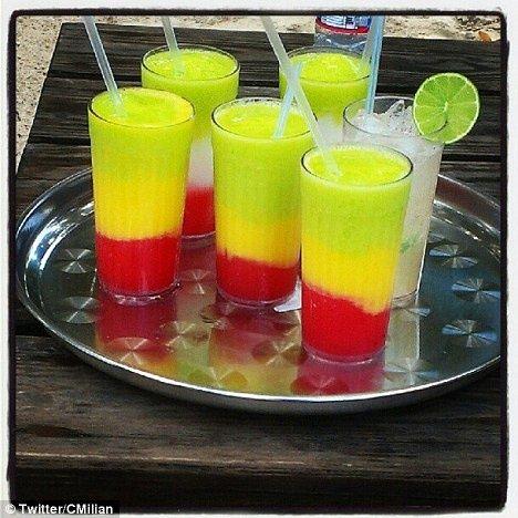 Bob Marley Cocktail - Rum ,strawberry daquiri red mix, yellow fresh mango, rum, sweet and sour mix, blue curaco.