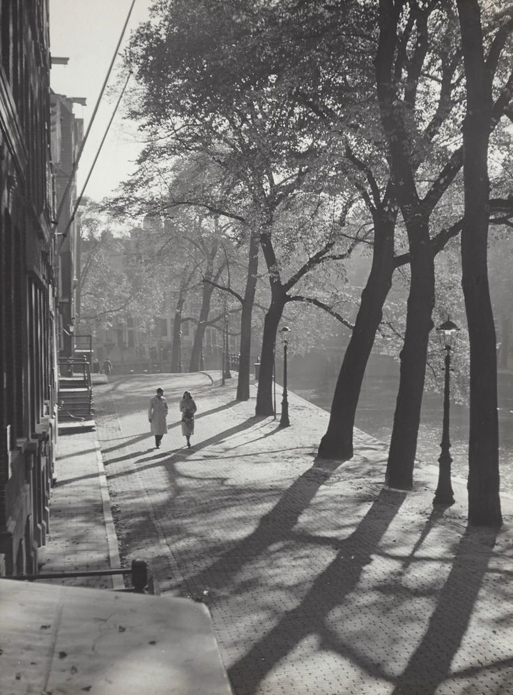 1952-1957. A couple walking along a canal in Amsterdam. Photo Kees Scherer. #amsterdam #1952