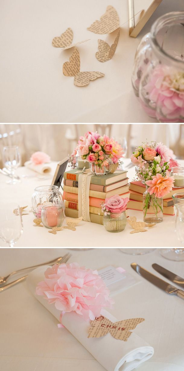 love the low vase sitting on top of the books.  You could always split your tables.  Have half of the books standing up and half laying like this.  Use 2 different styles of arrangements