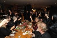 A group champagne toast celebrating the 15th anniversary of the Woodstock Film Festival.