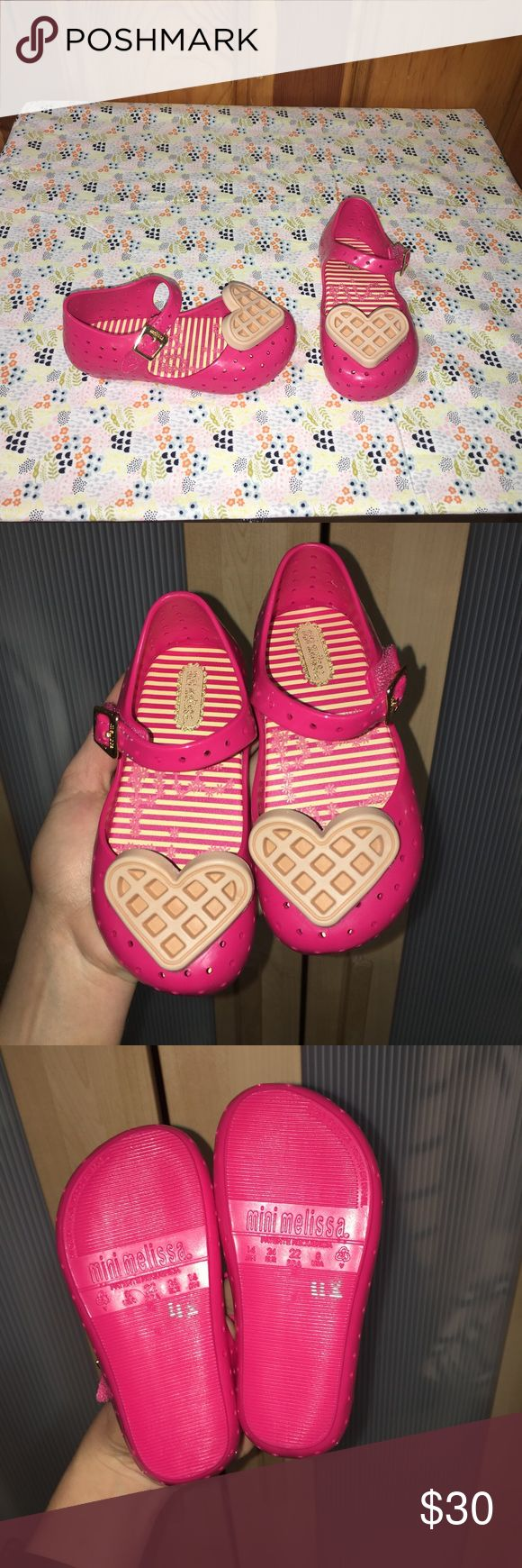 NWOT Girl's Mini Melissa Flats NWOT Girl's Mini Melissa Flats in pink. Hot pink color with light pink hearts at toes. Adorable and easy to wash!! Girl's size 8. Mini Melissa Shoes