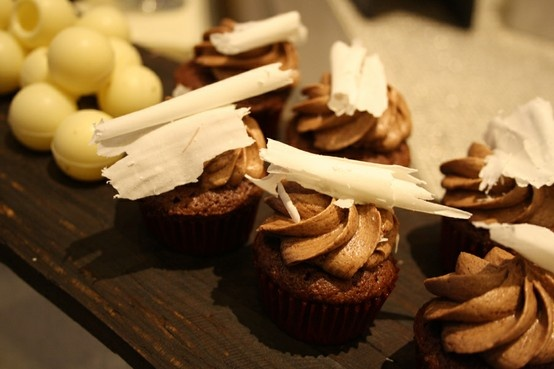 Mövenpick Hotel & Apartments Bur Dubai -   Nothing beats the classics – Mövenpick Hotel & Apartments Bur Dubai takes the classic chocolate cupcake to a higher level, topped with dark chocolate icing and white chocolate shavings.