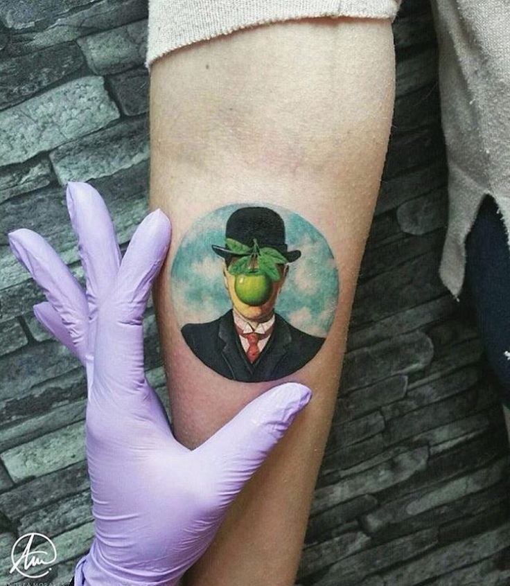 Tattoo by Andrea Morales; Son of Man by René Magritte