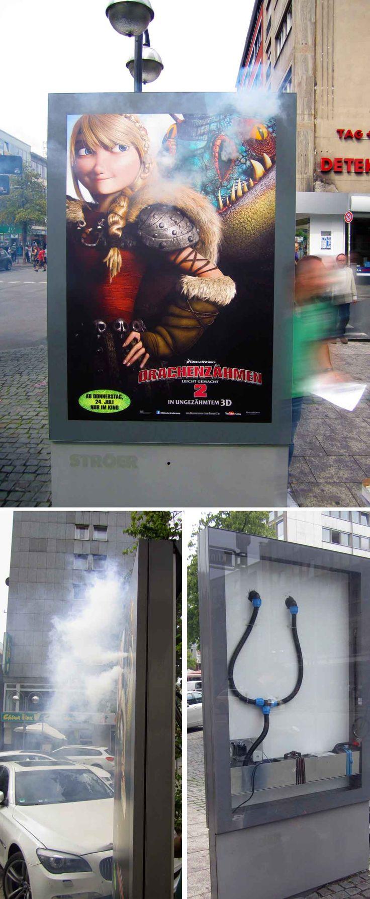 """#Special Ad #Sonderumsetzung für den Kino-Film  """"Drachenzähmen leicht gemacht 2"""". Eine Nebelmaschine sorgt dafür, dass - so wie es sich für Drachen gehört - Rauch aus den Nasenlöchern kommt. Standort: Frankfurt a.M., Juli 2014 #City-Light-Poster"""