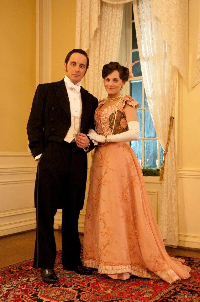 Her dress is gorgeous. They are such a cute couple.