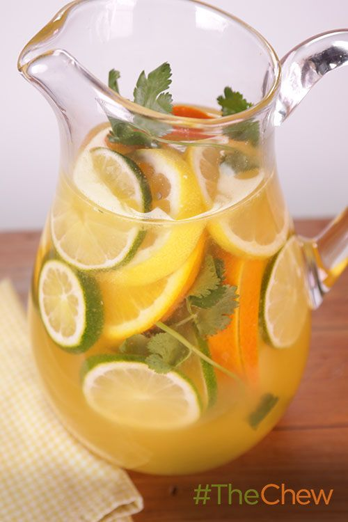 Never choose between a margarita and sangria again with this two-for-one White Margarita-Sangria cocktail!  INGREDIENTS: 1 bottle dry white wine 1 1/2 cups white tequila 1 cup triple sec 1/2 cup lime juice 1 cup orange juice 2 limes (sliced) 1 lemon (sliced) 1 orange (sliced) 1 bunch cilantro