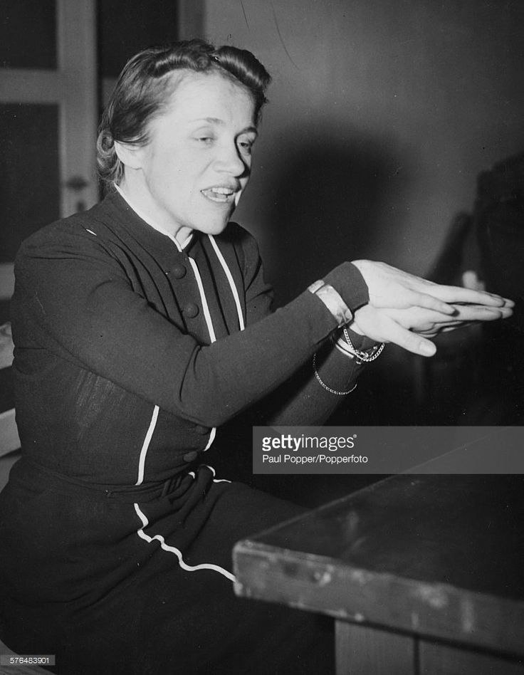 Captain Hanna Reitsch (1912-1979), German test pilot and holder of the Iron Cross First Class, gestures as she recounts her escape from the Reich Chancellery bunker in Berlin, a few hours before the death of Adolf Hitler, Oberursel, Germany on December 14th 1945.