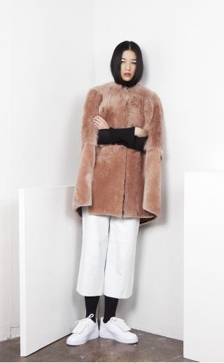 https://az697095.vo.msecnd.net/vnext/products/331/8786/Onar_Damask-Roses-in-Space-Collection_clothing_coats-and-outerwear_Almond_SIGHA-Fur-Cape_320x518_v3_1223631187.jpg
