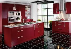Stylish burgundy gloss kitchen with contrasting black tiled floor