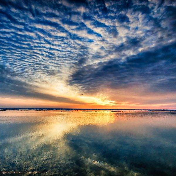 Wadden Sea, The Netherlands....must make it here, even if it requires a boat and a giant coat.