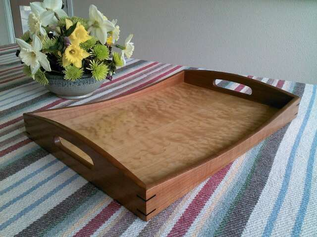 "This serving tray is made from cherry and big leaf curly maple veneer, but could be made from any combination of hardwoods. The overall size is 14 ¼"" wide and 19"" long. The height is 2 ¾"". The thickness of the sides is ½"". The bottom panel is 3/8"" thick."
