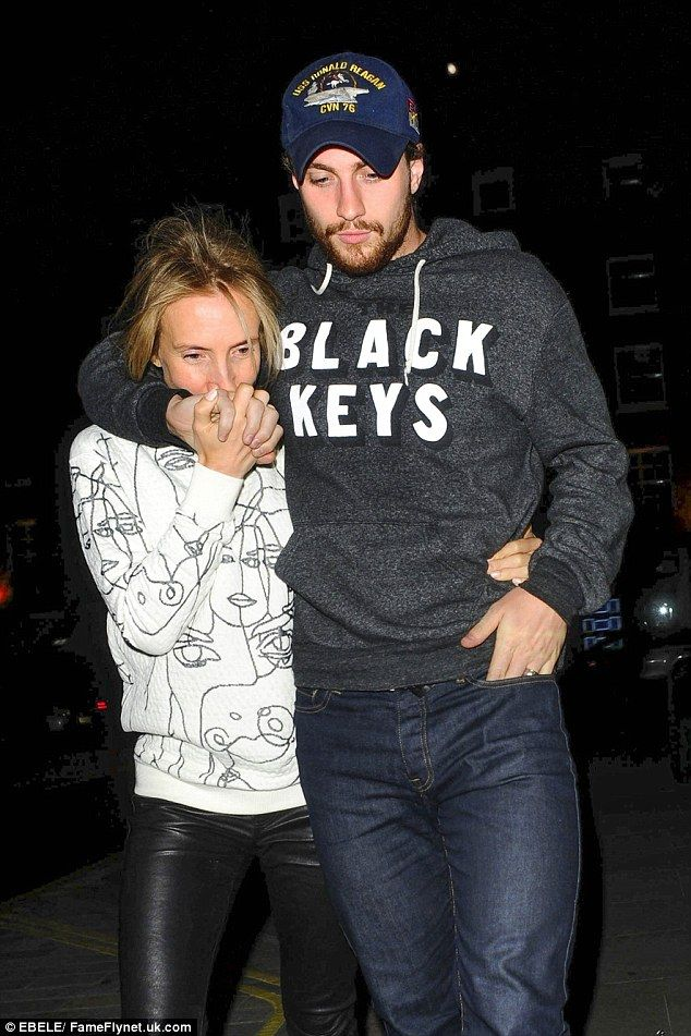 Aaron Taylor-Johnson cuddles wife Sam Taylor-Wood in close as they dress down for romantic date night at Chiltern Firehouse