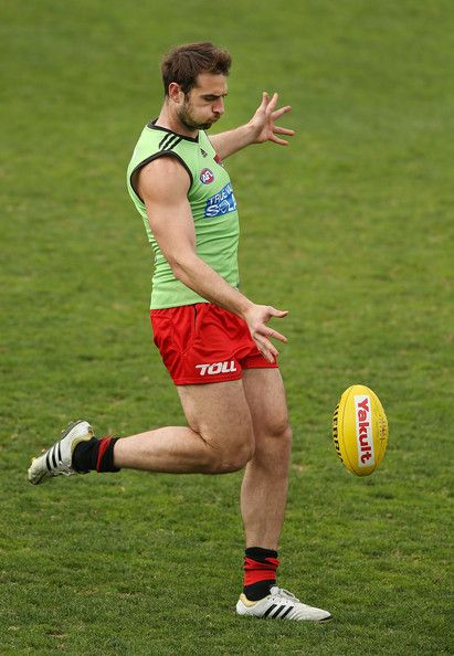 Jobe Watson kicks the ball during an Essendon Bombers training session at Windy Hill on August 30, 2013 in Melbourne, Australia.