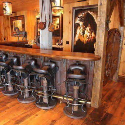 Old western horse saddle barstools.