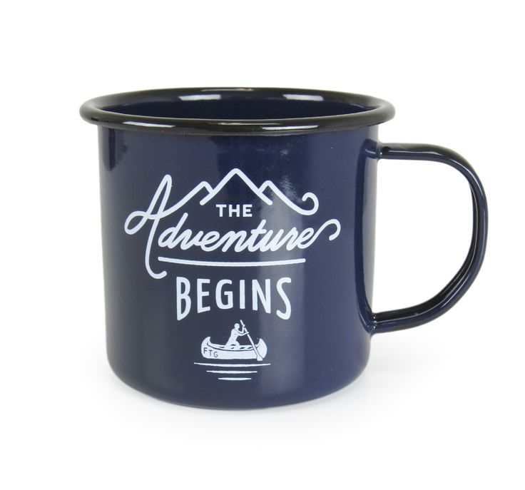 """This Blue/Black enamel mug features The Adventure Begins design on the front with the Gentlemen's Hardware logo on the opposite side. A compass is printed on the bottom of the mug. 3"""" tall x 3.5"""" wide"""