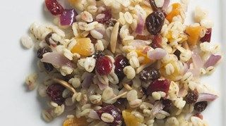 Colorful pieces of dried fruit stud this warm barley salad, which goes savory with a honey mustard dressing. Feel free to use whatever mix of dried fruit you have on hand in your cupboard.