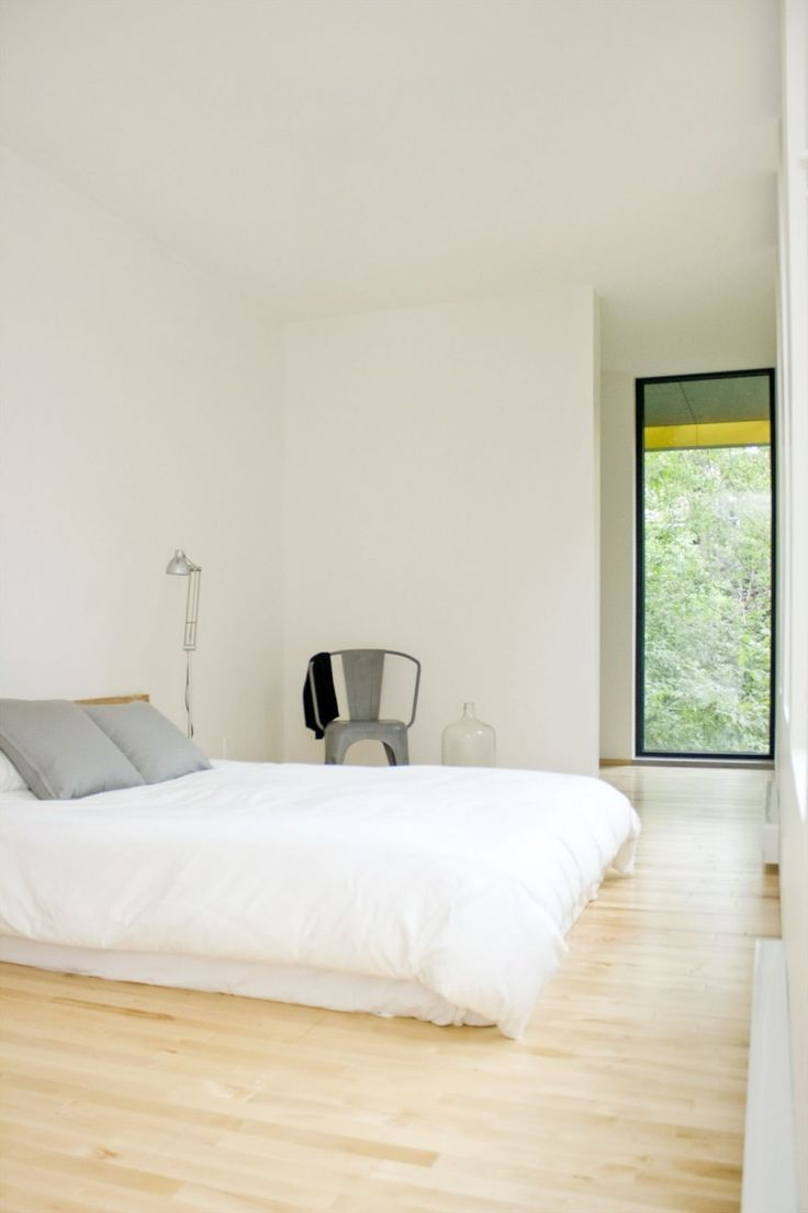 Apartments. Comfortable Contemporary Apartment Design of a Makeover Building: Appealing Minimalist Bedroom Design Ideas With White Blanket And Wooden Flooring Also Grey Pillows ~ wegli