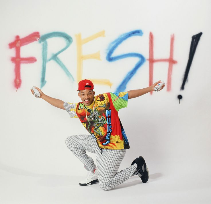 """Vibrant streetwear was an early '90s style staple. Will Smith became a bonafide trendsetter on The Fresh Prince of Bel Air with his colorful tracksuits, Zubaz pants, and impressive collection of Jordans. Hip-hop group TLC followed suit, and often performed in oversized t-shirts and mens' shorts, complete with cartoonish accessories in crazy colors.   """"NBC/\r\nNBCUniversal""""  - MarieClaire.com"""