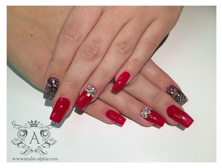 All red square nails with black pattern and swarovski crystals.
