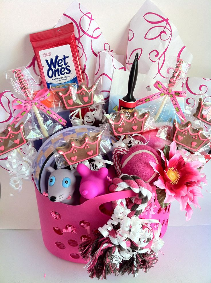 Dog Gift Baskets...for all you dog lovers! This cute basket is the perfect  starter to welcome your new  bundle of fur! Guaranteed to make the new doggie feel at home:) Packaged in a cute reusable pink plastic basket. Visit us at www.thebullypantry.com
