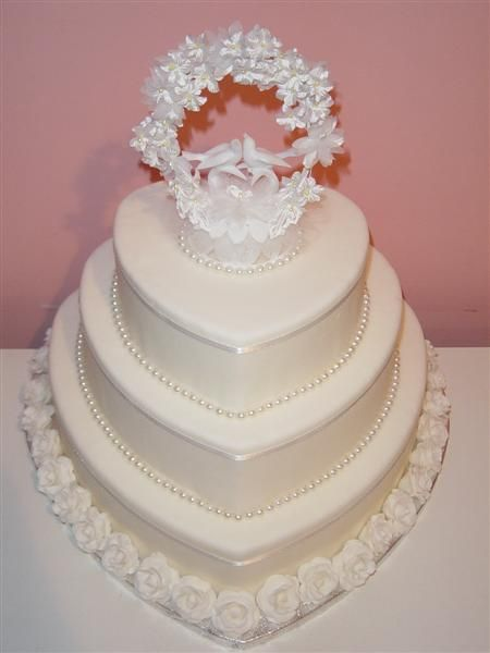 Beautiful Wedding cake, I had a two tier heart shaped wedding cake much like this one.  My wedding was on Valentines Day so I incorporated red roses on the cake.