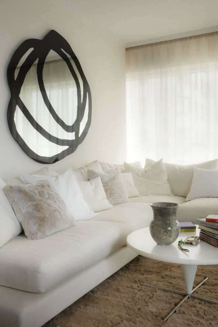Decorative assymetrical mirror Ghost by Gervasoni, available at MOOD showroom, Warsaw. Living room designed by Warsaw based studio Mood Works-Karina Snuszka and Dorota Kuć. #mood #moodworks #mirror #roundmirror #assymetricalmirror #decorativemirror #ghostmirror #gervasoni