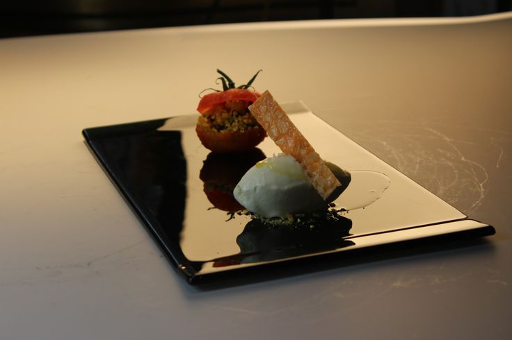 Stuffed confit tomatoes with dry fruits and nuts, extra virgin olive oil ice cream