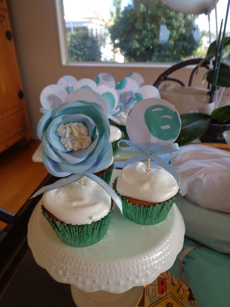 Paper flower and cupcake toppers for grand daughter's party.