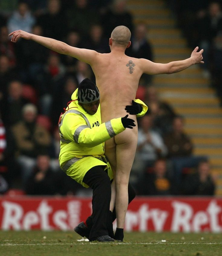 A streaker is tackled by a steward during a League One match between Leyton Orient and Brighton in November 2007.