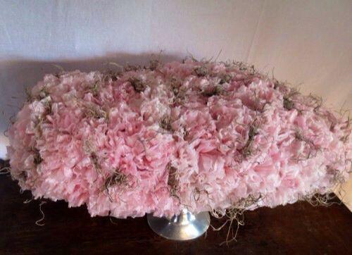 Bloemen van wax met verlichting in verwerkt