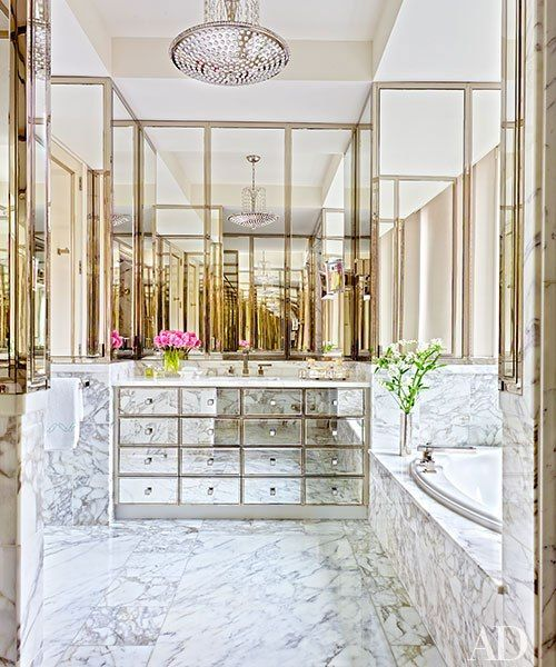 LOVE THE STORAGE MIRRORED DRAWERS - A ceiling fixture by Chameleon Fine Lighting accents the master bath, which is outfitted with a mirrored vanity.