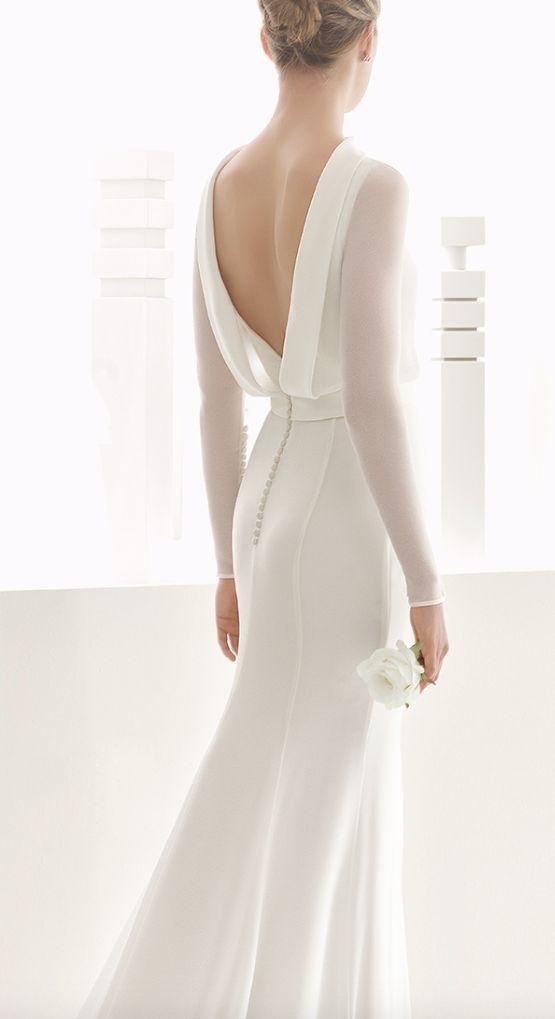 Sleek long-sleeve white wedding dress with low draped back