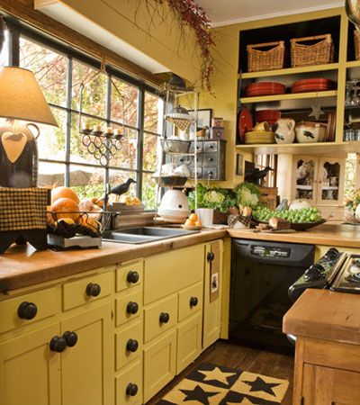 The yellow cabinets are a sunny choice for a Country Kitchen.  A little too much clutter, but, otherwise cute.