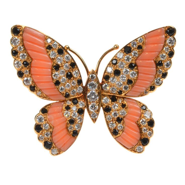 Unusual brooch / pendant designed as a butterfly in 18ct yellow gold its open wings pavé set with brilliant cut diamonds and black onyx and each enhanced by a carved coral 'stripe' Van Cleef & Arpels, Paris circa 1980 38.5k USD