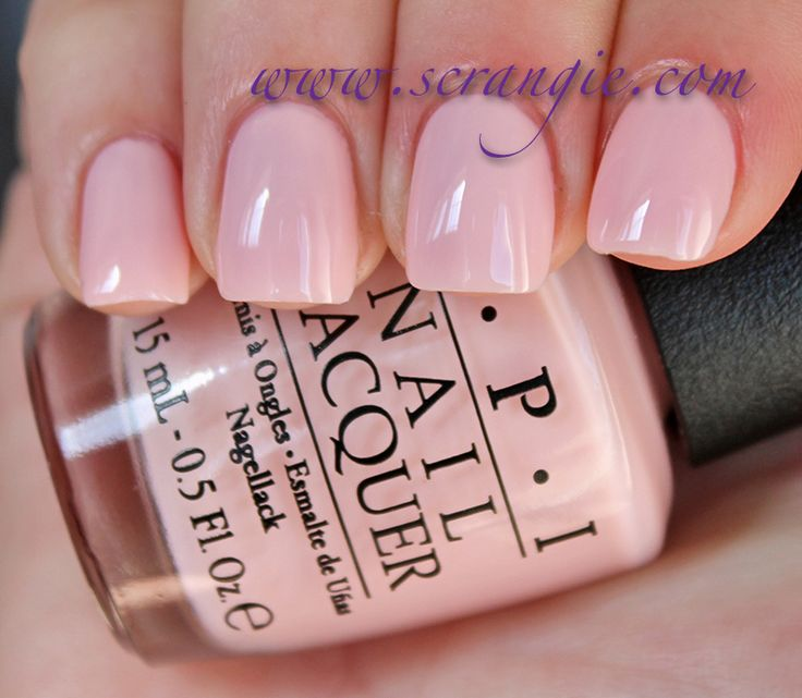 Very pretty on me :|: OPI I Theodora You.  A light, neutral, sheer pink creme.  More pink than white, but also has enough warmth in it to seem almost peach-colored in certain lights.  Very nice glossy-thick finish to this one, almost a creamy/milky jelly finish.