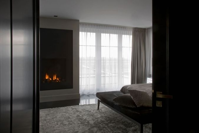 bed room with fireplace.
