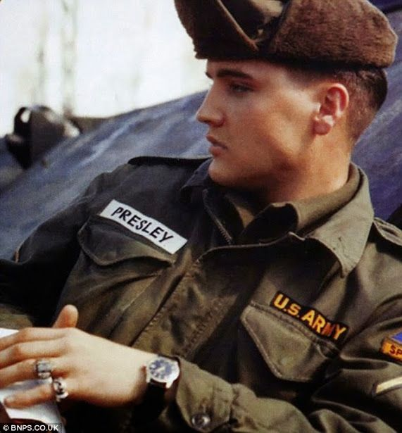 Elvis is seen wearing the Omega Constellation watch, which recently sold for $50,000, while on military duty in the late 1950s.  Elvis loved his watches and it is rare to see a photograph showing his wrist when he is not wearing one.