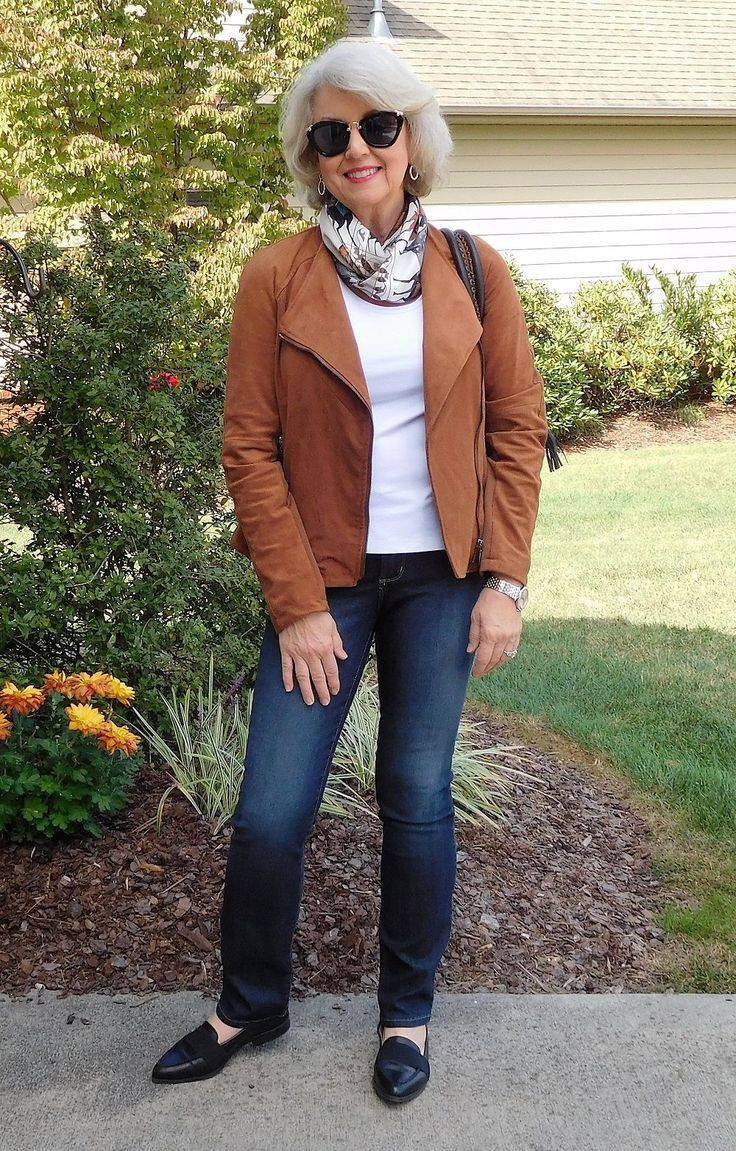 I wore a faux suede moto style jacket from Dillard's last year over a tank top by Peck and Peck from Stein Mart. The jeans are NYDJ. The flat shoes are old by BCBGeneration via Saks Off 5th.The bag is from Uno Alla Volta.