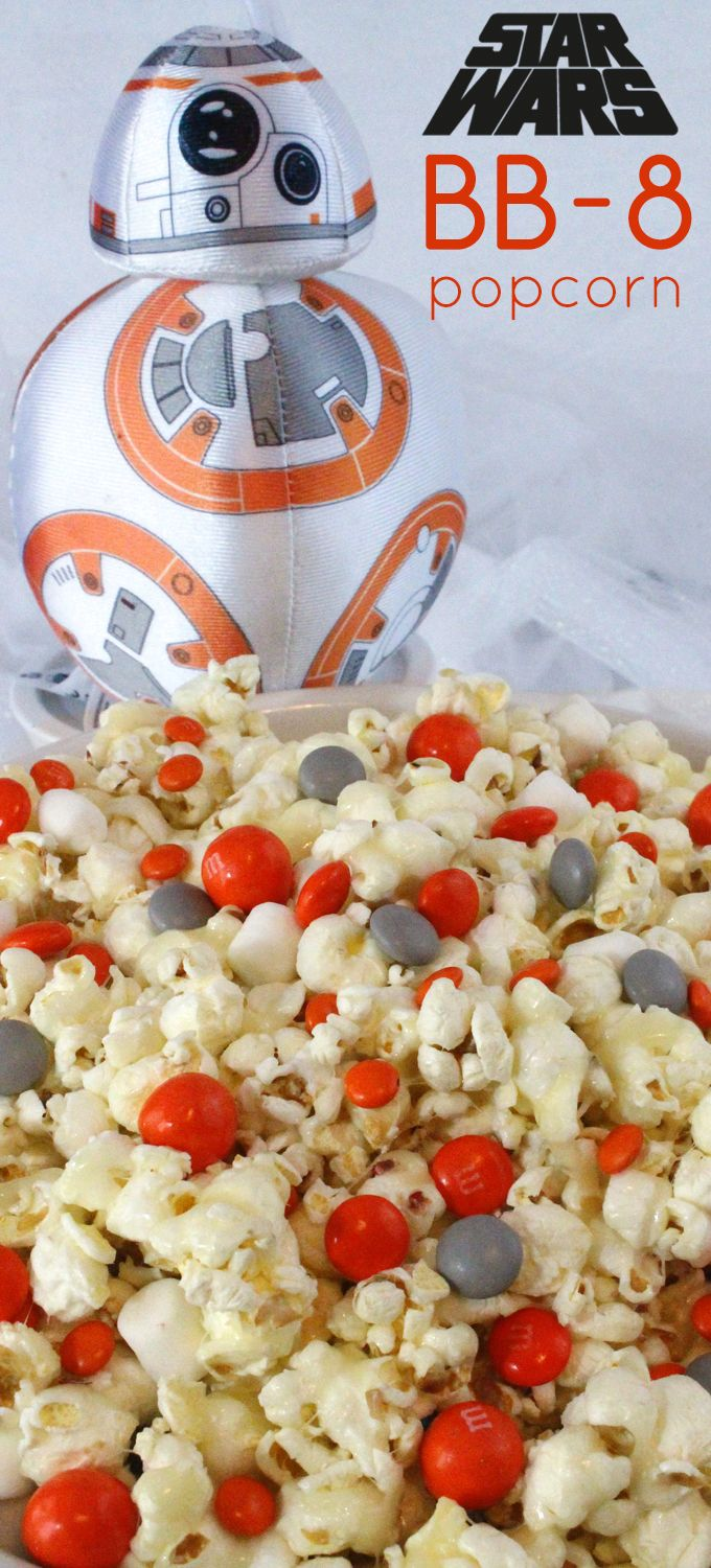 Star Wars BB-8 Popcorn - a fun popcorn treat for Star Wars fans. Sweet, salty, crunchy and delicious and it is so easy to make. It would be a great Star Wars Party Food or a fun dessert for your Star Wars movie watching party! Follow us for more fun Star Wars Party Ideas.