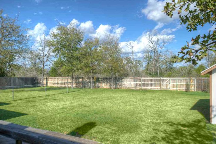 The private backyard offers a spacious storage building ...