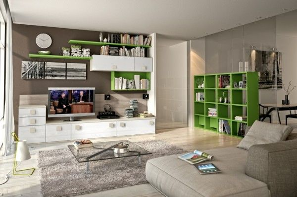 Living-Room-Bookshelves-TV-Cabinets-Il salotto contemporaneo ha delle linee semplici e pulite, particolarmente essenziali, le unità sono montate al muro per massimizzare lo spazio. Quando viene studiato le unità scelte vengono montate sul muro e la loro versatilità consente molteplicità di schemi di unioni fra i vari pezzi.