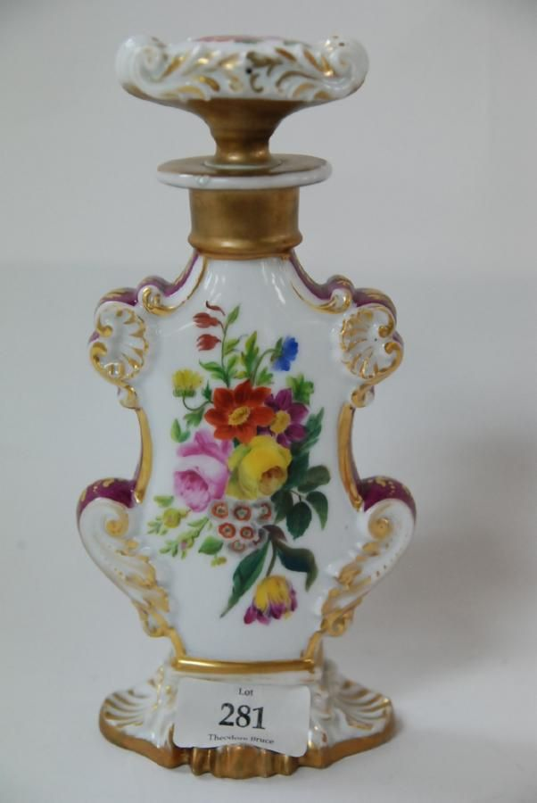 A 19th century French porcelain perfume bottle decorated by