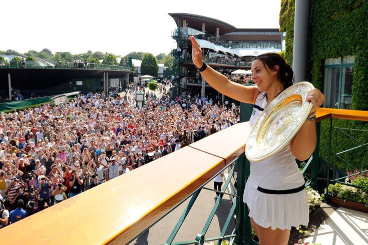 2013 #Wimbledon Champion Marion #Bartoli shows off her first Grand Slam trophy to fans.