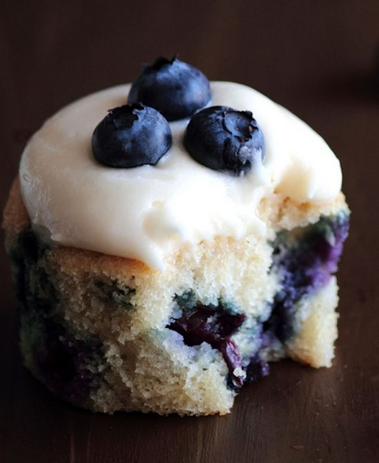Blueberry Cream Cheese Cupcakes ~ The cupcakes have a bright, exuberant flavor aided by a good dose of vanilla and a smattering of blueberries. The cream cheese frosting, however, elevates these cupcakes from ordinary to extraordinary.