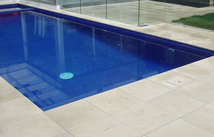 White limestone paver, pool surround
