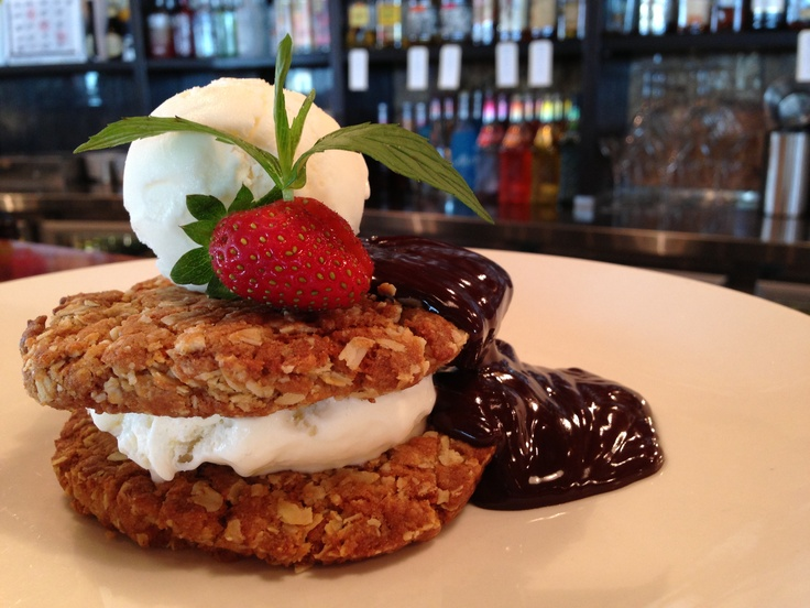 ANZAC Biscuit Giant Sandwich with vanilla bean ice-cream, chocolate sauce and strawberries. Available @ The Quarie.