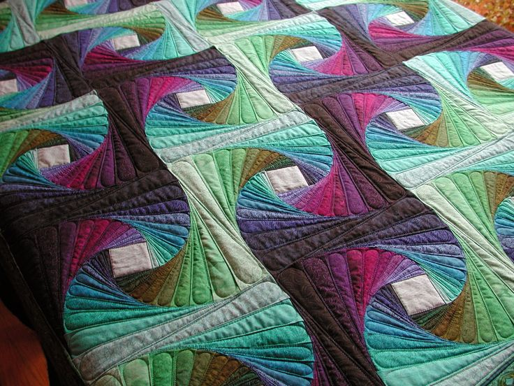 """What beautiful movement in this """"Square Iris"""" quilt by Kathleen and quilted by Janet M of Murdock Manor. Paper-pieced pattern available here: http://www.handcraftedgreetings.com/iristmpl.php"""