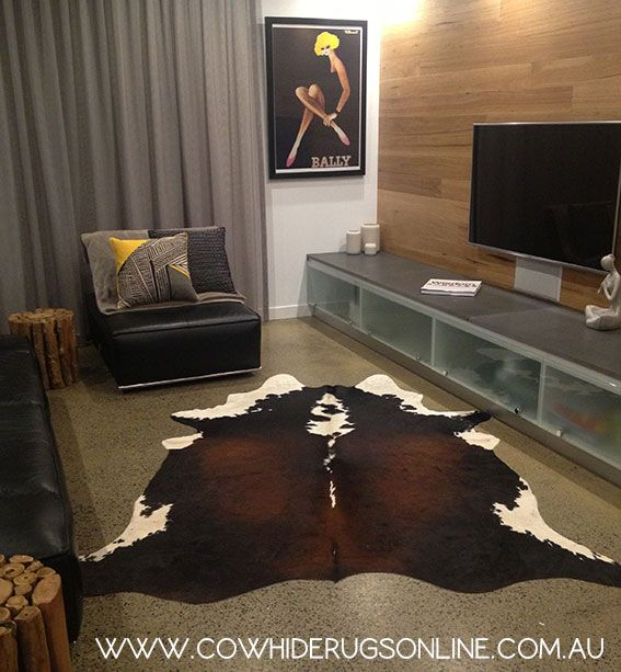 One Of Our Reddish Brown Cowhide Rugs Shown In A Living