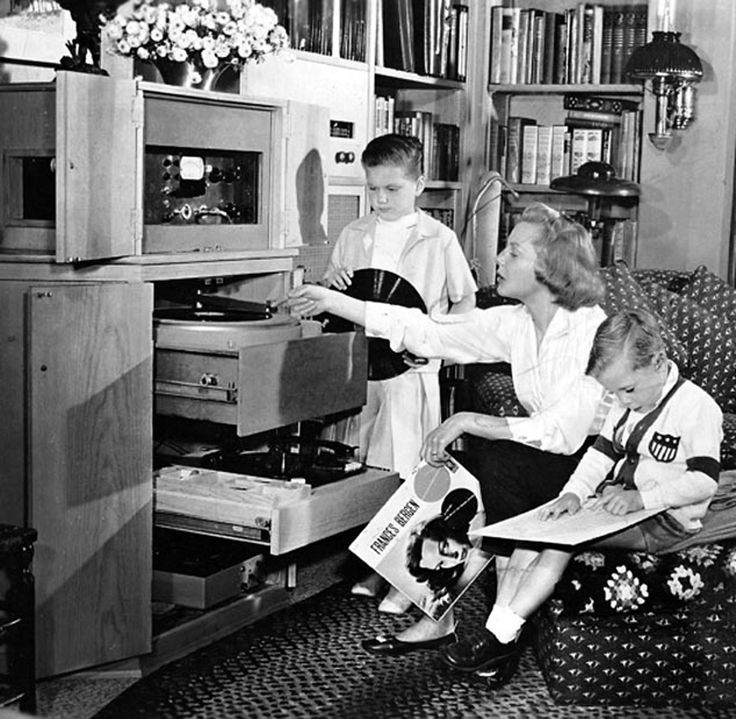 June Allyson spins a new record by her friend Frances Bergen, for her children, Dick and Pamela.